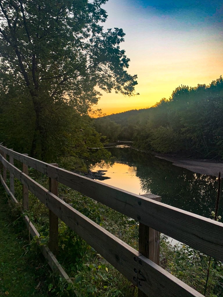 View of the slow moving river at sunset